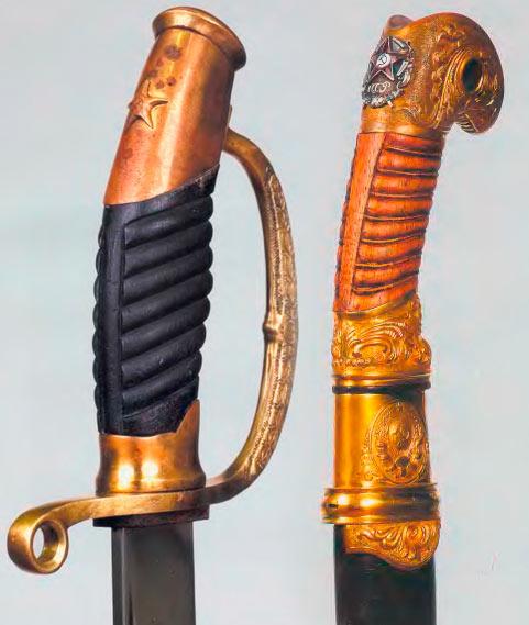 Эфесы наградных шашек образца 1927 г. (справа) и 1940 г (слева)